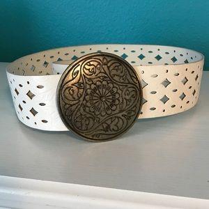 White belt with large, floral belt buckle